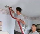 Men Cleaning out Air Duct Cleaning - Air Duct Cleaning